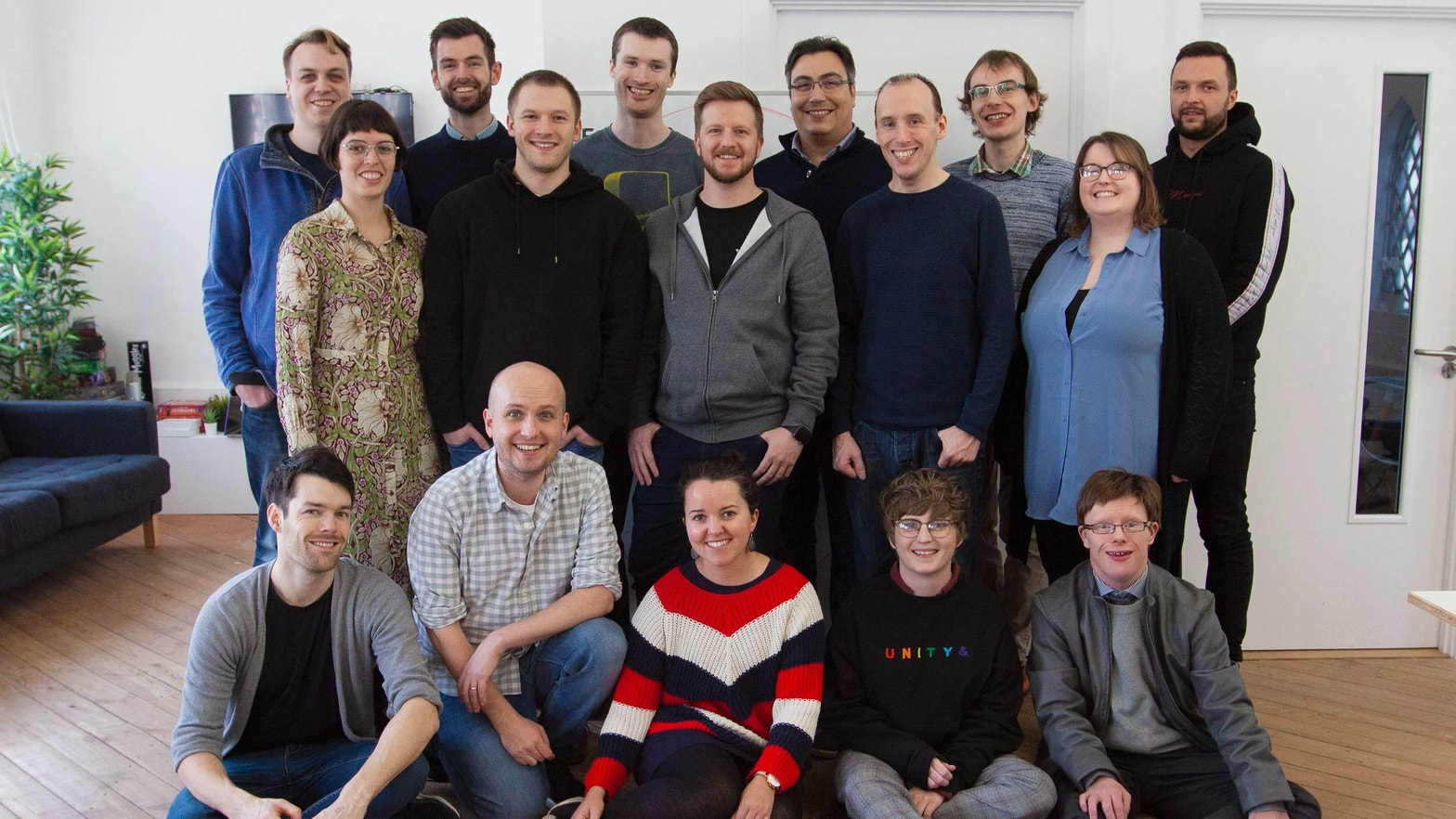 The 16 member Developer Society team in their studio